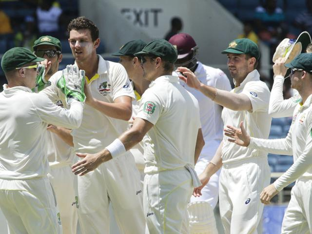 Australian-bowler-Josh-Hazlewood-third-left-high-fives-teammates-after-taking-the-wicket-of-West-Indies-Kemar-Roach-who-was-caught-behind-for-7-runs-during-the-third-day-of-their-second-cricket-Test-match-in-Kingston-Jamaica-on-June-13-2015-Australia-won-the-match-by-277-runs-and-Hazlewood-was-adjudged-man-of-the-series-AP-Photo