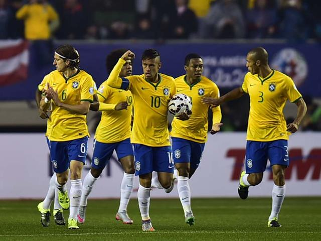 Brazil-s-forward-Neymar-celebrates-after-scoring-against-Peru-during-their-2015-Copa-America-football-championship-match-in-Temuco-Chile-on-June-14-2015-AFP-Photo