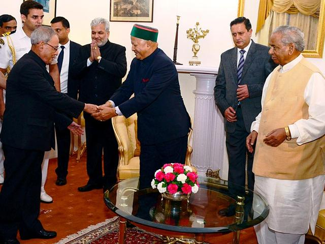 President-Pranab-Mukherjee-left-greets-Himachal-Pradesh-chief-minister-Virbhadra-Singh-as-governor-Kalyan-Singh-right-looks-on-at-The-Retreat-in-Chharabra-village-Shimla-on-Sunday-HT-Photo