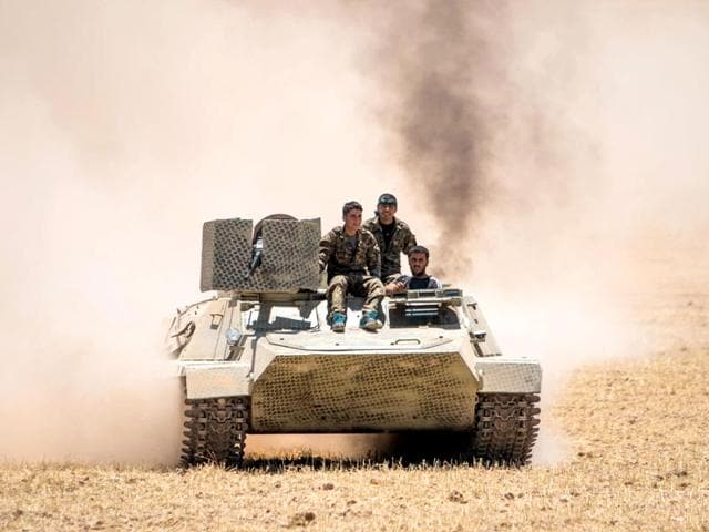 Kurdish-fighters-driving-a-tank-to-the-town-of-Tal-Abyad-Photo-Reuters