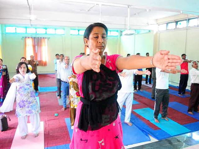 Syed-Rubab-Fatima-47-does-yoga-every-day-and-trains-others-at-a-government-run-training-centre-HT-Photo