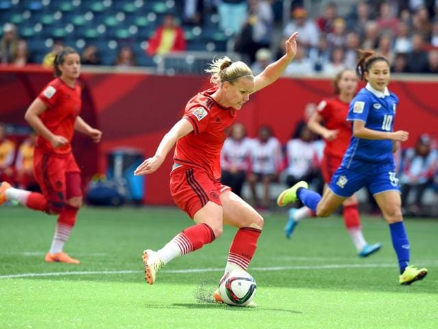 Germany-s-forward-Lena-Petermann-C-kicks-the-ball-at-Thailand-s-goalpost-during-their-Group-B-football-match-of-the-2015-Fifa-Women-s-World-Cup-at-the-Winnipeg-Stadium-in-Winnipeg-Canada-on-June-15-2015-AFP-Photo
