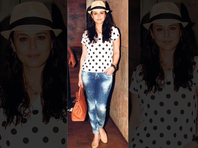 Preity-Zinta-cute-in-acid-washed-jeans-and-a-polka-dotted-tee-Nude-wedges-and-a-fedora-hat-completed-her-look