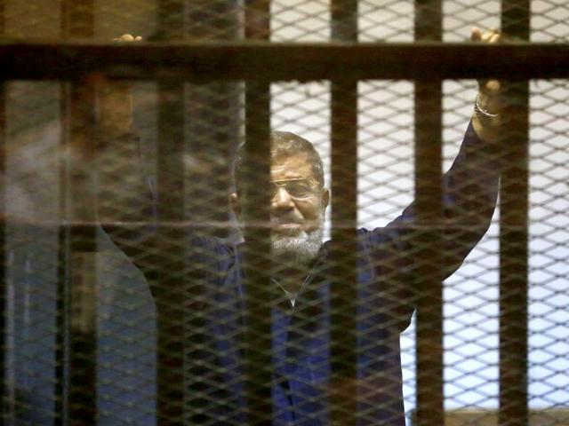 An-Egyptian-court-confirmed-a-death-sentence-handed-to-ousted-Islamist-President-Morsi-over-a-2011-mass-prison-break-case-on-June-16-2015-A-separate-ruling-upheld-a-life-sentence-for-Morsi-and-confirmed-death-sentences-against-16-others-over-charges-of-conspiring-with-foreign-groups-AP-Photo