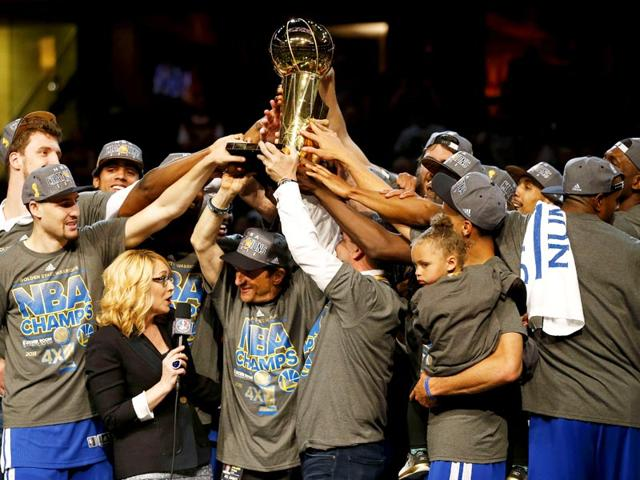 The-Golden-State-Warriors-celebrate-with-the-Larry-O-Brien-NBA-Championship-Trophy-after-winning-Game-Six-of-the-2015-NBA-Finals-against-the-Cleveland-Cavaliers-at-Quicken-Loans-Arena-on-June-16-2015-in-Cleveland-Ohio-AFP-Photo