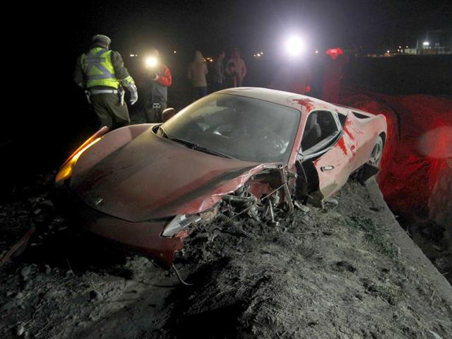 The-wrecked-remains-of-the-Ferrari-of-Chilean-footballer-Arturo-Vidal-remains-in-the-town-of-Buin-50-kilometres-south-of-Santiago-after-the-footballer-crashed-the-car-when-driving-drunk-on-June-16-2015-AFP-Photo