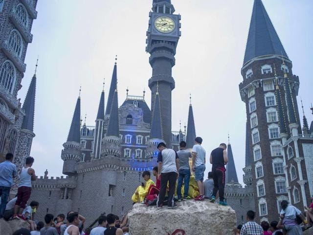 A-Chinese-university-has-earned-comparisons-with-Harry-Potter-s-Hogwarts-due-to-its-bizarre-castle-campus-and-Confucian-style-ceremony-for-its-degree-graduates-AFP-Photo
