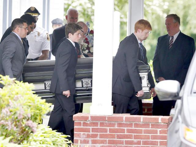 Pallbearers-carry-the-casket-with-Keith-Broomfield-s-remains-from-Grace-Baptist-Church-in-Hudson-Mass-following-his-funeral-on-Wednesday-Broomfield-was-killed-in-Syria-while-fighting-the-Islamic-State-group-AP-Photo