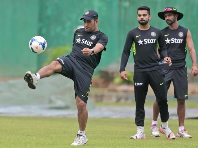 MS-Dhoni-plays-with-a-football-as-teammates-Virat-Kohli-and-Shikhar-Dhawan-watch-during-a-practice-session-on-June-17-a-day-ahead-of-India-s-one-day-international-cricket-match-against-Bangladesh-AP-Photo