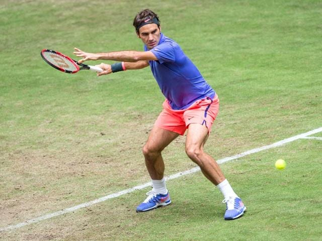 Roger-Federer-in-action-against-Ernests-Gulbis-on-June-17-at-Halle-Federer-has-won-85-tournaments-in-his-career-including-three-this-season-at-Brisbane-Dubai-and-Istanbul-AFP-Photo