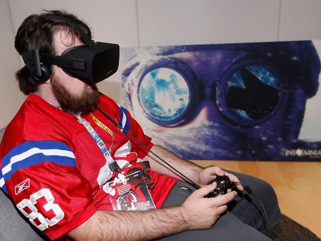 Game-enthusiast-Jacob-Mix-tests-out-the-virtual-reality-head-mounted-display-Oculus-Rift-CV1-at-the-Annual-Gaming-Industry-Conference-E3-at-the-Los-Angeles-Convention-Center-in-Los-Angeles-California-Photo-Christian-Petersen-Getty-Images-AFP