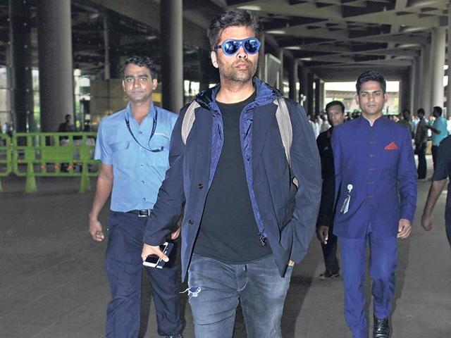 Karan-Johar-walks-out-of-the-Mumbai-airport-in-style-Photos-Viral-Bhayani-Yogen-Shah