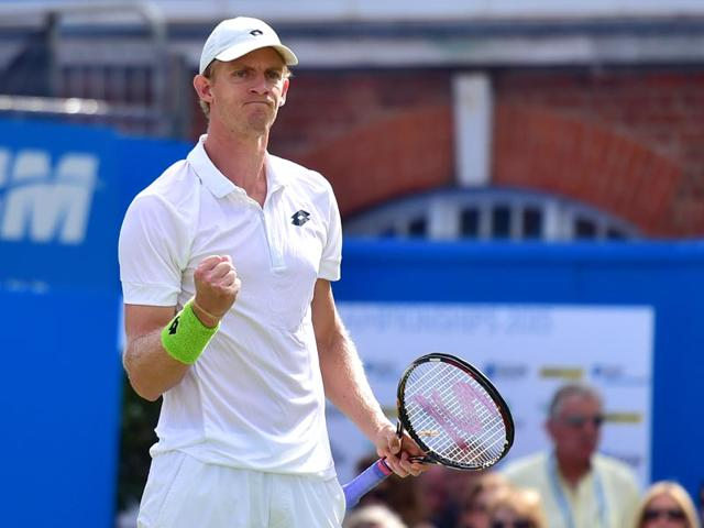 South-Africa-s-Kevin-Anderson-reacts-after-beating-Switzerland-s-Stanislas-Wawrinka-in-a-second-round-match-at-the-ATP-Aegon-Championships-tennis-tournament-at-the-Queen-s-Club-in-London-on-June-17-2015-AFP-Photo