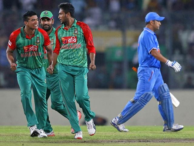 Bangladesh-s-Shakib-Al-Hasan-second-right-celebrates-with-teammates-Taskin-Ahmed-left-and-Tamim-Iqbal-second-left-the-dismissal-of-India-s-captain-MS-Dhoni-right-during-the-first-one-day-international-cricket-match-in-Dhaka-Bangladesh-on-June-18-2015-AP-Photo