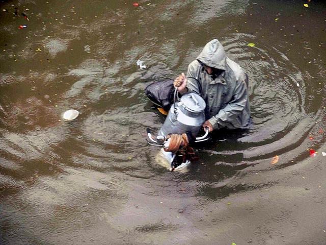A-milkman-wades-through-a-water-logged-road-after-heavy-rains-near-Dadar-in-Mumbai-PTI-Photo