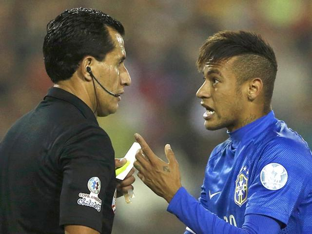 Brazil-s-Neymar-argues-with-referee-Enrique-Osses-after-receiving-a-yellow-card-during-the-first-round-Copa-America-2015-soccer-match-against-Colombia-at-Estadio-Monumental-David-Arellano-in-Santiago-Chile-on-June-17-2015-Brazil-lost-0-1-Reuters-Photo