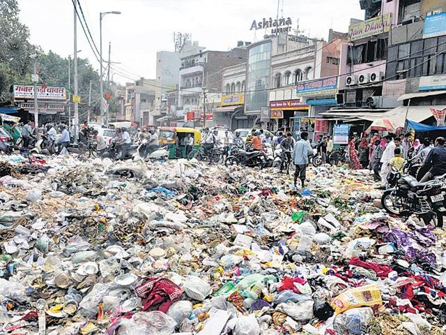 Abandoned garbage, missing sewer connections, damaged roads ail residents of illegal colonies
