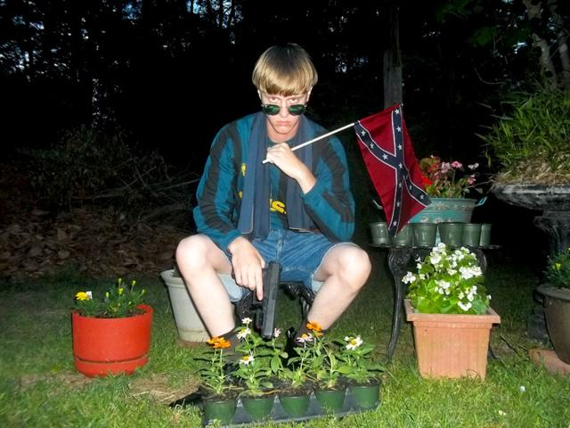 This-undated-image-that-appeared-on-Lastrhodesian-com-a-website-being-investigated-by-the-FBI-in-connection-with-the-Charleston-massacre-shooting-suspect-Dylann-Roof-shows-Roof-posing-for-a-photo-while-holding-a-Confederate-flag-AP-Photo