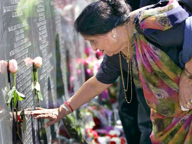 A-woman-touches-the-name-of-a-family-member-on-the-memorial-for-the-victims-of-Air-India-Flight-182-on-the-Toronto-waterfront-Reuters-File-Photo