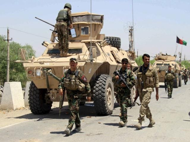 Afghan special forces arrive for a battle with the Taliban in Kunduz city, northern Afghanistan. NATO troops have arrived to provide support for Afghan forces after the Taliban captured the strategically important city for the first time in 14 years.