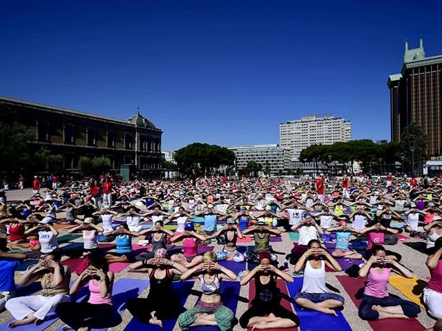 International-Yoga-Day-being-celebrated-at-Colon-square-in-Madrid-AFP-Photo