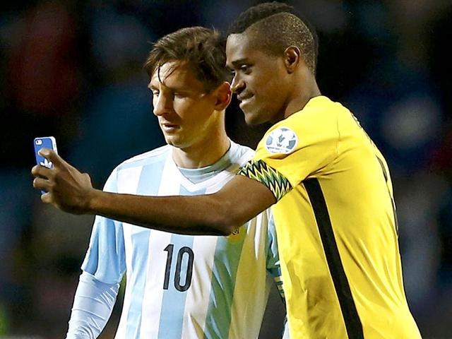 Jamaica-s-DeShorn-Brown-takes-a-selfie-with-Argentina-s-Lionel-Messi-following-their-first-round-Copa-America-2015-soccer-match-at-Estadio-Sausalito-in-Vina-del-Mar-Chile-on-June-20-2015-Argentina-won-the-match-1-0-Reuters-Photo