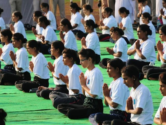 A-group-of-women-and-children-perform-Yoga-at-Ekant-Park-in-Bhopal-on-Sunday-Praveen-Bajpai-HT-photo