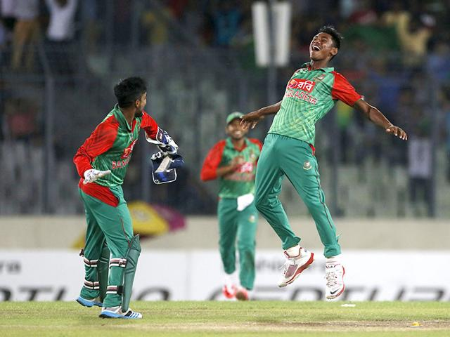 Bangladesh-players-congratulate-teammate-Mustafizur-Rahman-3L-after-the-seamer-dismissed-an-Indian-batsman-during-the-second-ODI-match-between-Bangladesh-and-India-in-Dhaka-on-June-21-2015-AFP-Photo
