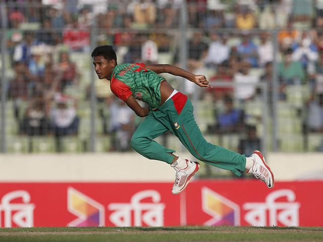 Bangladesh-s-Mustafizur-Rahman-celebrates-with-teammates-the-dismissal-of-India-s-Ravichandran-Ashwin-during-the-first-one-day-international-cricket-match-between-them-in-Dhaka-AP-Photo