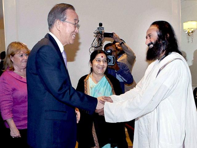 UN-secretary-general-Ban-Ki-moon-shakes-hands-with-Art-of-Living-founder-Sri-Sri-Ravishankar-as-external-affairs-minister-Sushma-Swaraj-looks-PTI-Photo