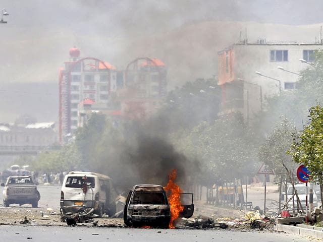 Vehicle-is-seen-on-fire-after-a-blast-near-the-Afghan-parliament-in-Kabul-Afghanistan-Reuters-Photo