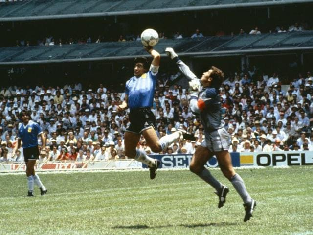 Diego-Maradona-scores-his-Hand-of-God-goal-past-England-goalkeeper-Peter-Shilton-in-the-1986-World-Cup-quarterfinal-on-June-22-1986-Getty-Images