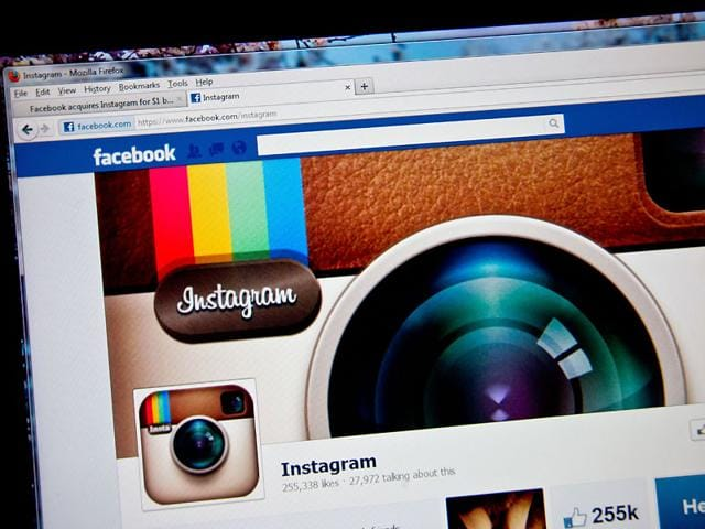 An-attendee-takes-a-photo-of-the-instagram-logo-during-a-press-event-at-Facebook-headquarters-in-Menlo-Park-California-Photo-AFP-Justin-Sullivan-Getty-Images