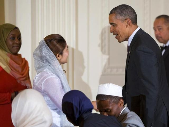 US-President-Barack-Obama-greets-guests-after-delivering-remarks-during-the-annual-Iftar-dinner-in-the-East-Room-of-the-White-House-AP-Photo-Evan-Vucci