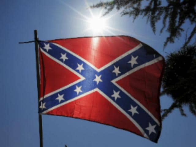 Bree-Newsome-takes-down-the-Confederate-Flag-from-a-pole-at-the-Statehouse-in-Columbia-South-Carolina-June-27-2015-Newsome-was-later-arrested-for-her-action-Reuters-Photo