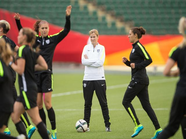 US-head-coach-Jill-Ellis-looks-on-as-her-team-warms-up-during-their-Fifa-Women-s-World-Cup-training-session-at-Commonwealth-Stadium-in-Edmonton-on-June-21-2015-Despite-the-USA-s-2-0-win-against-Colombia-2-0-in-the-round-of-16-the-team-has-not-been-as-convincing-and-dominant-as-they-were-expected-to-be-at-the-start-of-the-tournament-AFP-Photo