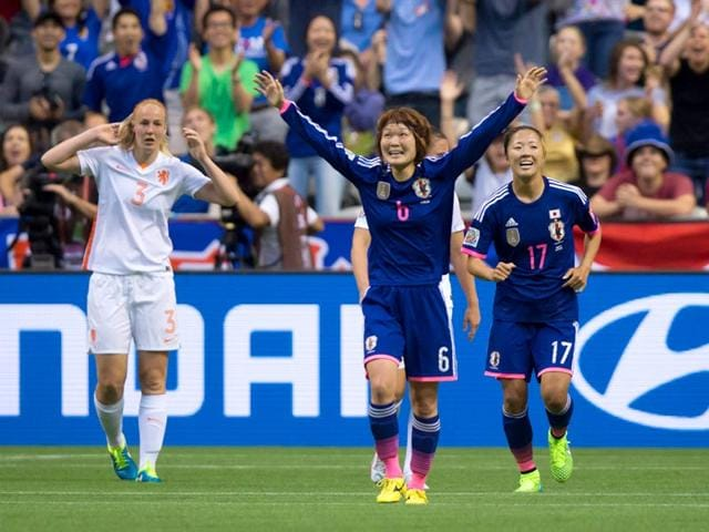 Japan-s-Mizuho-Sakaguchi-6-and-Yuki-Ogimi-17-celebrate-Sakaguchi-s-goal-as-Netherlands-Stefanie-van-der-Gragt-3-reacts-during-the-second-half-of-a-round-of-16-soccer-match-at-the-Fifa-Women-s-World-Cup-on-June-23-2015-in-Vancouver-Canada-Japan-won-the-match-2-1-AP-Photo