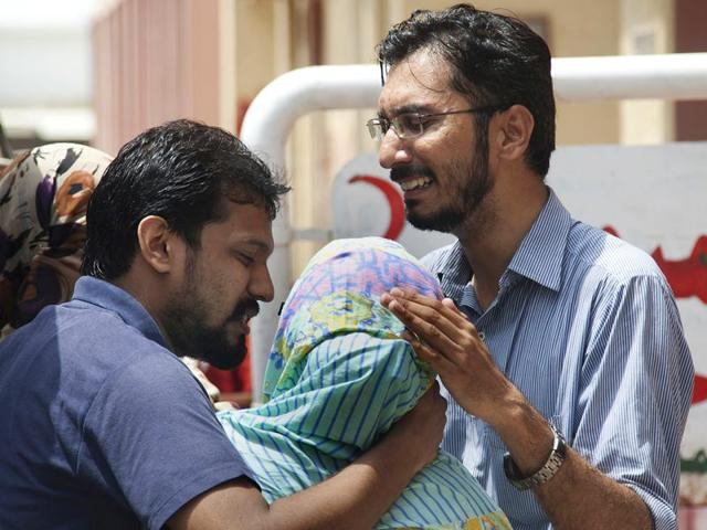 People-receive-drinking-water-from-a-volunteer-at-a-stall-set-up-outside-the-Jinnah-Postgraduate-Medical-Centre-JPMC-in-Karachi-Pakistan-Reuters-Photo