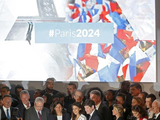 French-athletes-and-officials-pose-including-city-mayor-Anne-Hidalgo-front-row-5th-from-left-at-an-event-to-launch-the-Paris-bid-to-host-the-2024-Olympic-and-Paralympic-Games-in-Paris-France-on-June-23-2015-Paris-officially-announced-its-bid-to-bring-the-Olympics-back-to-the-French-capital-for-the-first-time-in-a-century-Reuters-Photo
