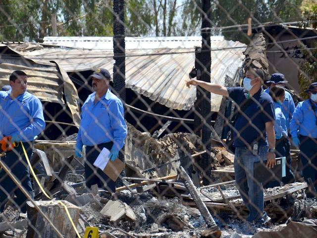 Forensics-work-among-the-rubble-of-a-nursing-home-after-it-caught-fire-in-Mexicali-Mexico-Tuesday-AP-Photo