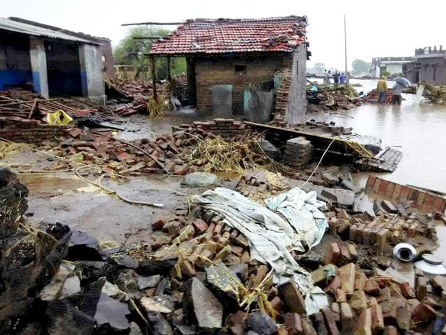 Damaged-houses-after-heavy-rains-in-Sultanpur-village-in-Rajkot-district-of-West-Gujarat-on-Wednesday-PTI-Photo
