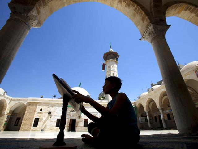 A-Palestinian-boy-reads-the-Koran-during-the-holy-month-of-Ramadan-at-Sayed-Hashim-Mosque-in-Gaza-City-REUTERS-Photo