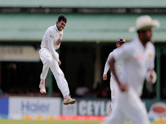 Sri-Lanka-s-Tharindu-Kaushal-left-jumps-as-he-celebrates-taking-five-wickets-during-the-first-day-of-the-second-Test-cricket-match-against-Pakistan-in-Colombo-Sri-Lanka-on-June-25-2015-AP-Photo