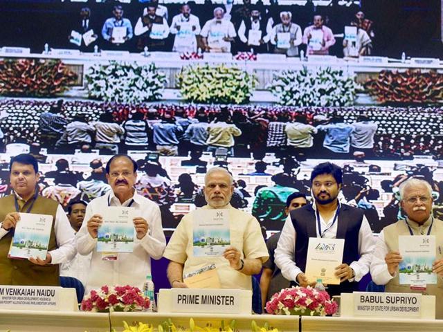 PM-Narendra-Modi-with-union-urban-development-minister-Venkaiah-Naidu-MoS-Babul-Supriyo-Mahrashtra-CM-Devendra-Fadnavis-and-Haryana-CM-ML-Khattar-at-the-launch-of-Smart-Cities-Mission-Atal-Mission-for-Rejuvenation-and-Urban-Transformation-AMRUT-and-Housing-for-All-Missions-in-New-Delhi-PTI-Photo