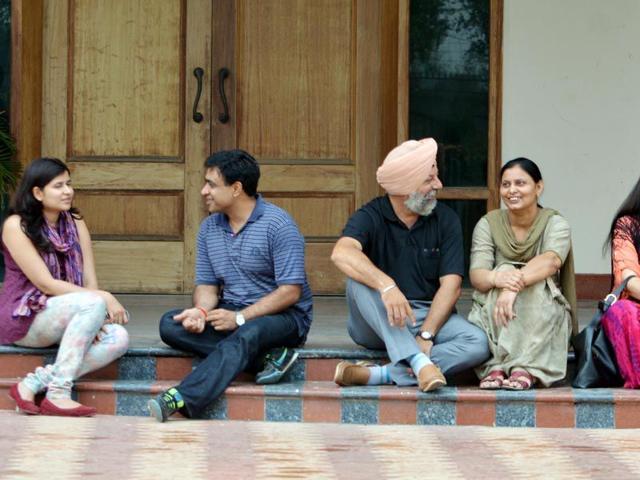 Vishal-Bamba-on-left--with-his-wife-Bhoumika-Bamba-Dr-Kawanjit-Singh-and-Jagroop-Kaur-centre-and-Nitin-Gupta-extreme-right-with-his-wife-Namrata-gupta-at-Bhatia-Neuropsychiatric-Hospital-and-De-addiction-center-in-Amritsar-Sameer-Sehgal-HT