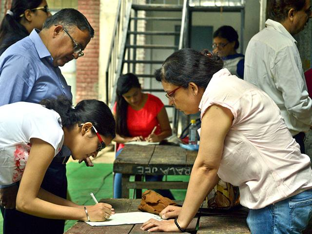 Students-fill-their-admission-forms-on-Thursday-after-the-first-cut-off-list-of-Delhi-University-came-out-on-Wednesday-HT-Photo-Chinmaya-Sharma