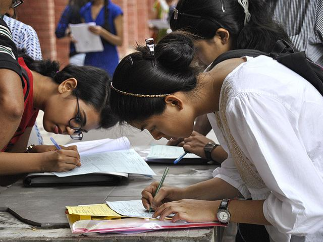 Admission-seekers-fill-their-forms-at-a-University-HT-Photo-Chinmaya-Sharma