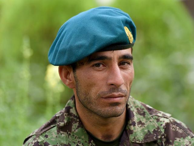 Afghan-soldier-Essa-Khan-Laghmani-talks-at-the-Afghan-Parliament-compound-in-Kabul-AFP-Photo
