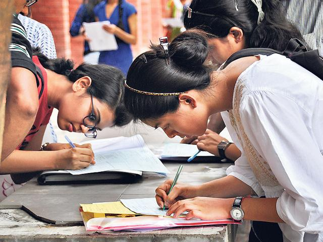 Students-wait-for-their-turn-to-collect-the-form-and-information-regarding-the-admission-process-at-Ramjas-College-after-the-first-cut-off-list-came-out-for-admissions--in-Delhi-University-HT-Photo-Chinmaya-Sharma