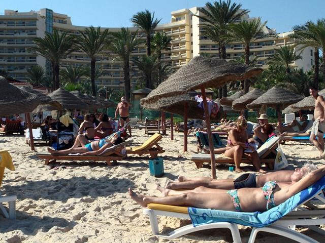 Police-officers-control-the-crowd-rear-while-surrounding-a-man-suspected-to-be-involved-in-opening-fire-on-a-beachside-hotel-in-Sousse-Tunisia-Reuters